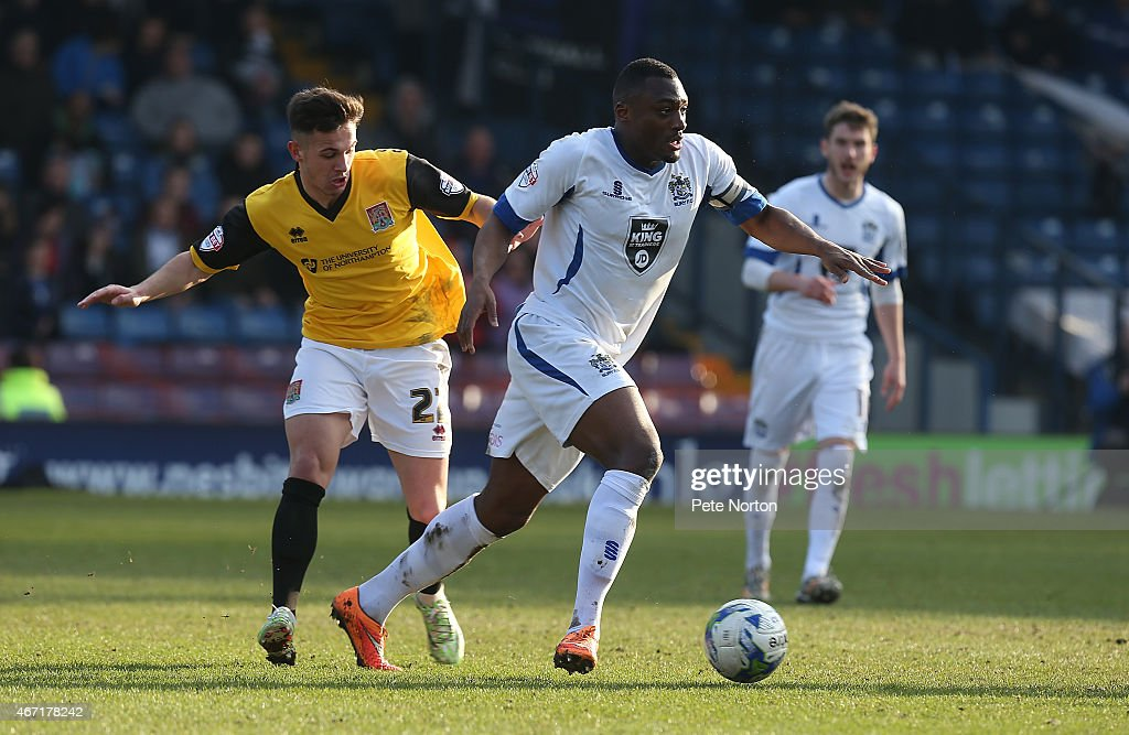 Nathan Cameron of Bury looks to move forward with the ball under pressure from Diego De Girolamo of Northampton Town during the Sky Bet League Two...