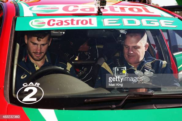 Nathan Charles of the Wallabies and Wallabies coach Ewen McKenzie sit in the V8 Supercar of Russell Ingall during an Australian Wallabies media...