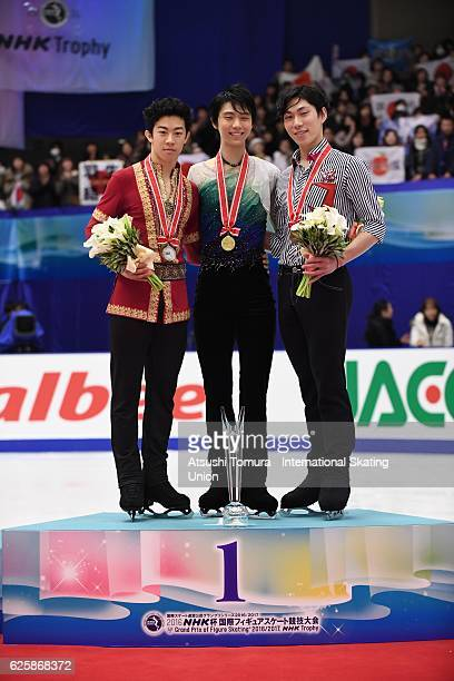 Nathan Chen of the USA Yuzuru Hanyu of Japan and Keiji Tanaka of Japan pose on the podium during the ISU Grand Prix of Figure Skating NHK Trophy on...