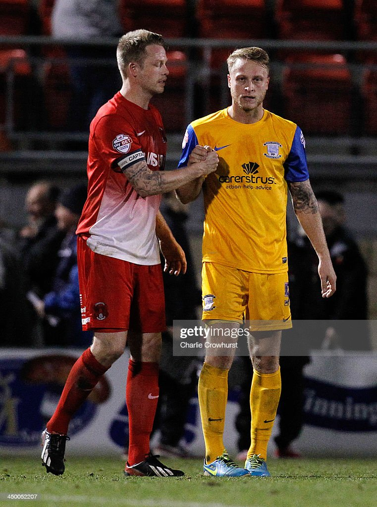 Nathan Clarke of Leyton Orient (L) congratulates brother Tom Clarke of Preston on the team's win during the Sky Bet League One match between Leyton Orient and Preston North End at The Matchroom Stadium on November 16, 2013 in London, England.