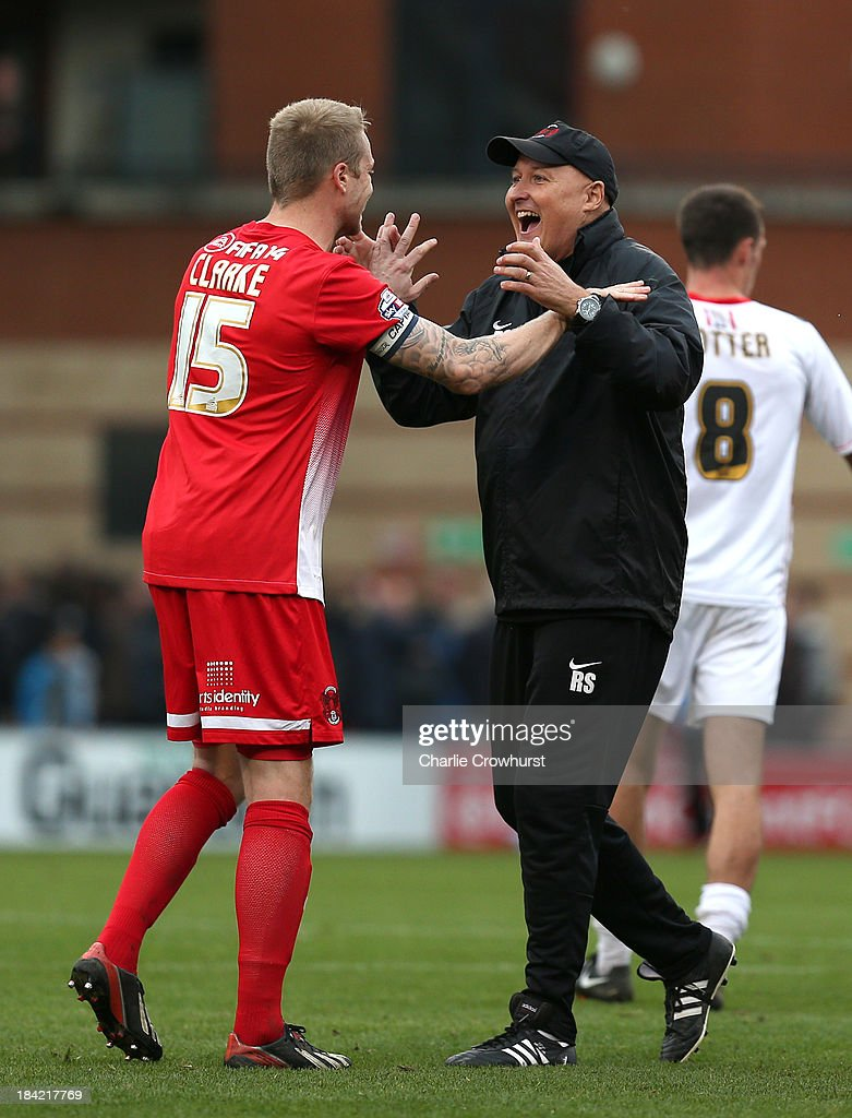 Nathan Clarke of Orient celebrates their win with manager Russell Slade during the Sky Bet League One match between Leyton Orient and MK Dons at The Matchroom Stadium on October 12, 2013 in London, England.