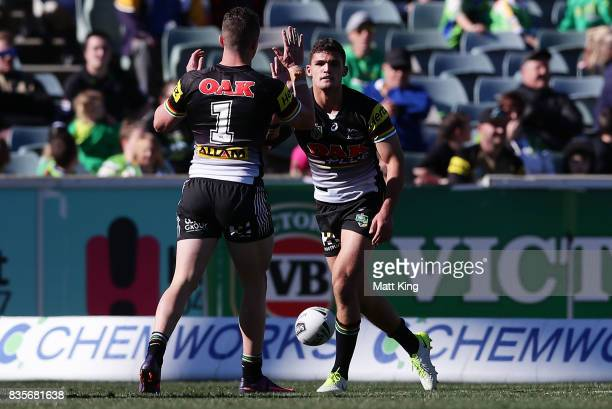 Nathan Cleary of the Panthers celebrates with Dylan Edwards after scoring a try the round 24 NRL match between the Canberra Raiders and the Penrith...