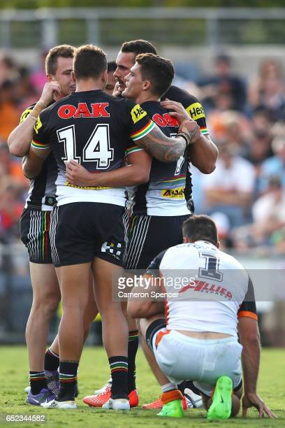 Nathan Cleary of the Panthers celebrates with team mates after scoring a try during the round two NRL match between the Wests Tigers and the Penrith...