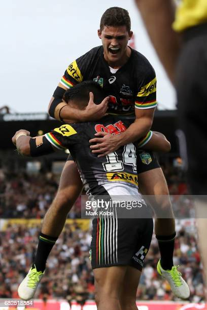 Nathan Cleary of the Panthers congratulates Tyrone Peachey of the Panthers as he celebrates scoring a try during the round 10 NRL match between the...
