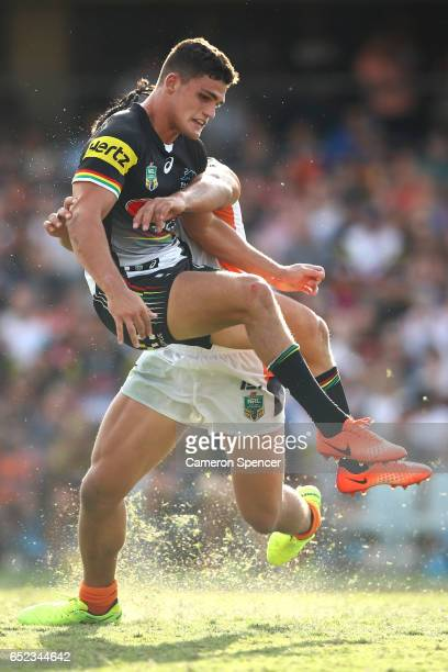 Nathan Cleary of the Panthers is tackled after clearing the ball with a kick during the round two NRL match between the Wests Tigers and the Penrith...