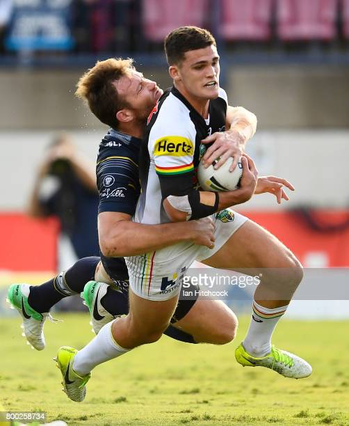 Nathan Cleary of the Panthers is tackled by Gavin Cooper of the Cowboys during the round 16 NRL match between the North Queensland Cowboys and the...
