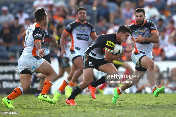 Nathan Cleary of the Panthers makes a break during the round two NRL match between the Wests Tigers and the Penrith Panthers at Campbelltown Sports...