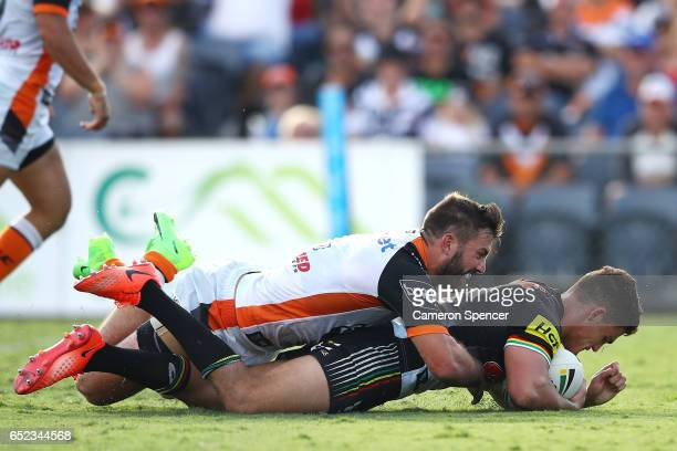 Nathan Cleary of the Panthers scores a try during the round two NRL match between the Wests Tigers and the Penrith Panthers at Campbelltown Sports...