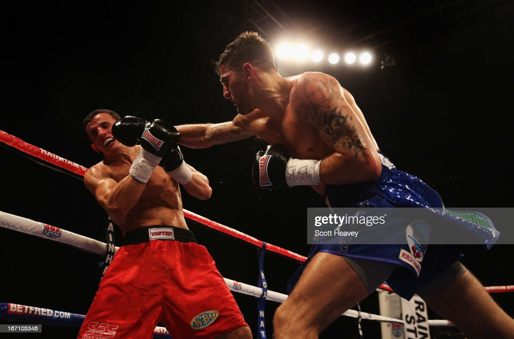 <a gi-track='captionPersonalityLinkClicked' href=/galleries/search?phrase=Nathan+Cleverly&family=editorial&specificpeople=5152922 ng-click='$event.stopPropagation()'>Nathan Cleverly</a> (R) in action against Robin Krasniqi during their WBO World Light-Heavyweight Championship bout at Wembley Arena on April 20, 2013 in London, England.