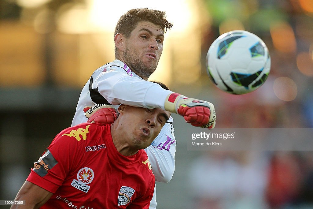 Nathan Coe of Melbourne makes a save under pressure from Iain Ramsay of Adelaide during the round 20 A-League match between Adelaide United and the Melbourne Victory at Hindmarsh Stadium on February 8, 2013 in Adelaide, Australia.