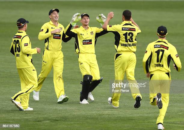 Nathan CoulterNile and Cameron Bancroft of the Warriors celebrate after taking the wicket of Callum Ferguson of the Redbacks during the JLT One Day...