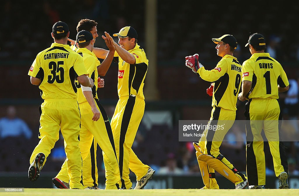 Nathan Coulter-Nile is congratulated after getting a wicket during the Ryobi One Day Cup match between the New South Wales Blues and the Western Australia Warriors at Sydney Cricket Ground on January 30, 2013 in Sydney, Australia.