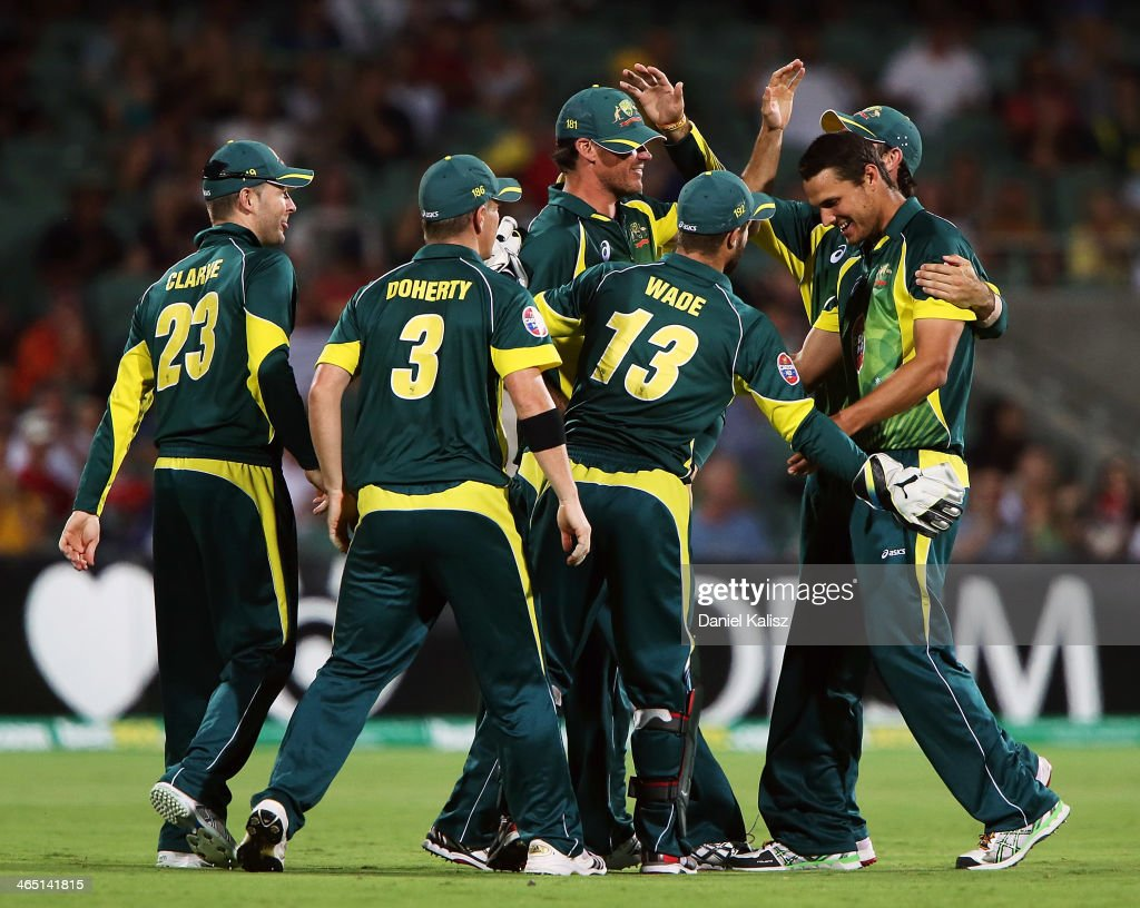 Nathan CoulterNile of Australia celebrates with his team mates after taking the wicket of Jos Buttler of England during game five of the One Day...