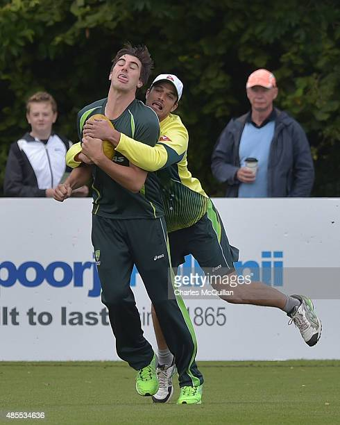 Nathan CoulterNile of Australia tackles team mate Patrick Cummins as they wait for play to begin during the ODI cricket game between Ireland and...