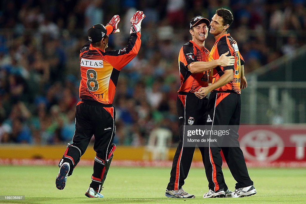 Nathan Coulter-Nile (R) of Perth celebrates after getting a wicket during the Big Bash League match between the Adelaide Strikers and the Perth Scorchers at Adelaide Oval on January 10, 2013 in Adelaide, Australia.