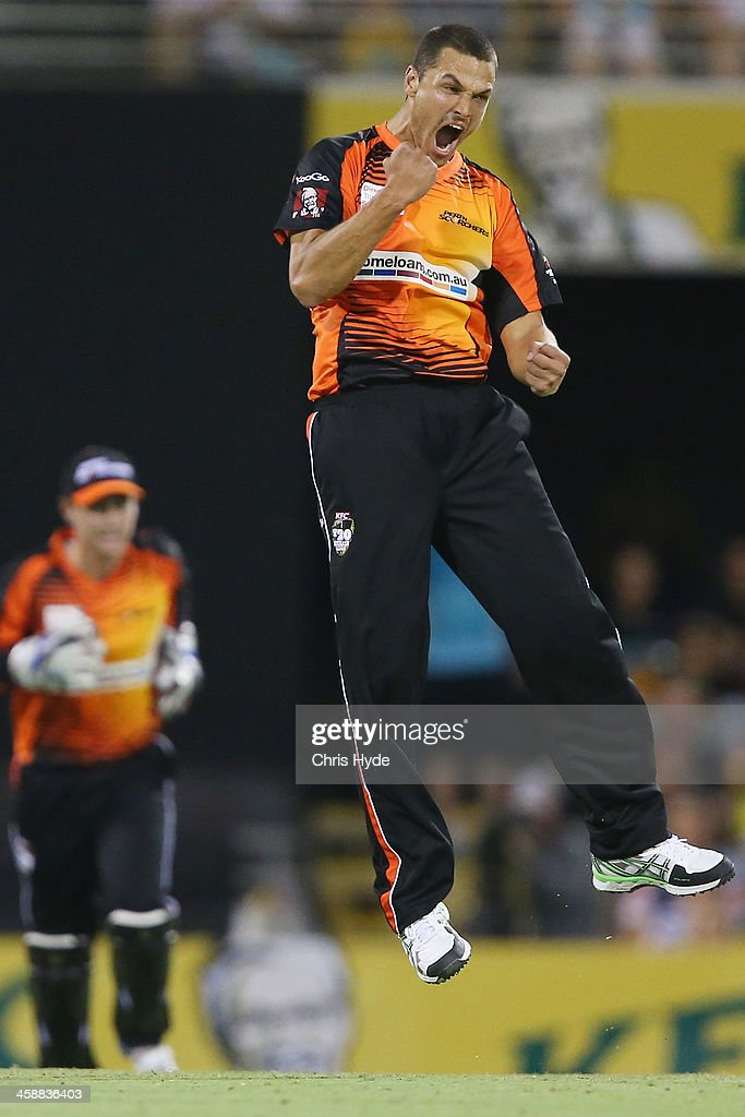 Nathan Coulter-Nile of the Scorchers celebrates after dismissing Joe Burns of the Heat during the Big Bash League match between the Brisbane Heat and the Perth Scorchers at The Gabba on December 22, 2013 in Brisbane, Australia.