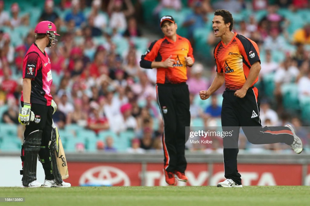 Nathan Coulter-Nile of the Scorchers celebrates the wicket of Steven Smith of the Sixers during the Big Bash League match between the Sydney Sixers and the Perth Scorchers at SCG on December 16, 2012 in Sydney, Australia.