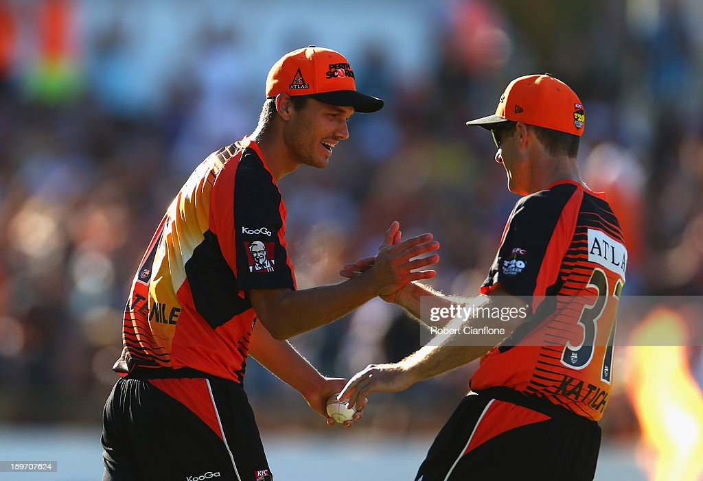 Nathan Coulter-Nile of the Scorchers celebrates with Simon Katich after taking a catch to dismiss Peter Forrest of the Heat during the Big Bash League final match between the Perth Scorchers and the Brisbane Heat at WACA on January 19, 2013 in Perth, Australia.