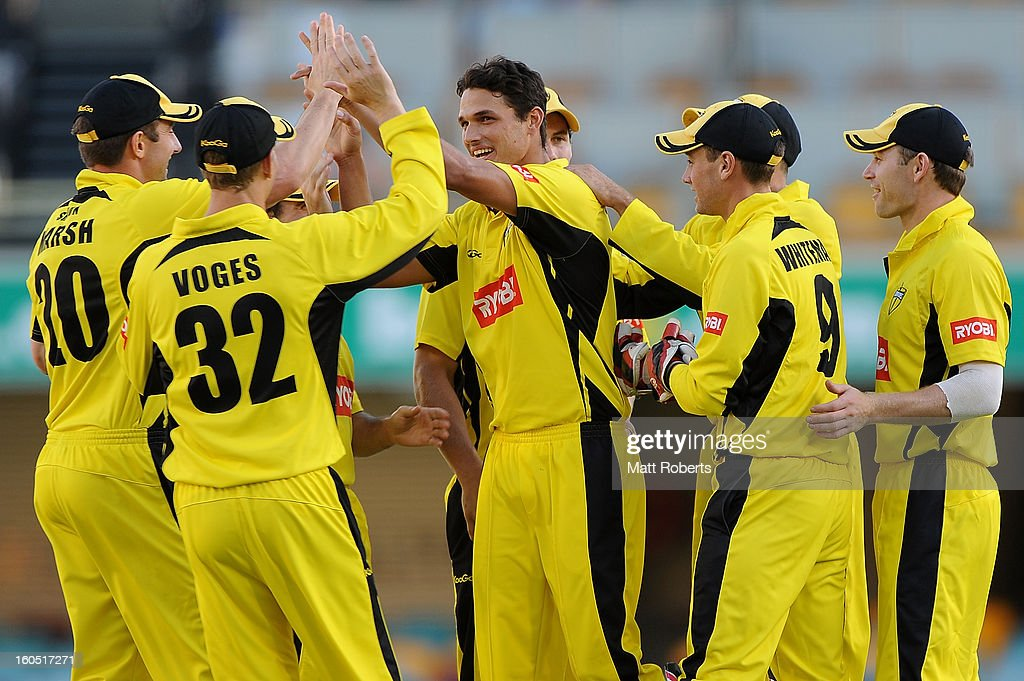 Nathan Coulter-Nile of the Warriors (C) celebrates a wicket with team mates during the Ryobi One Day Cup match between the Queensland Bulls and the Western Australia Warriors at The Gabba on February 2, 2013 in Brisbane, Australia.