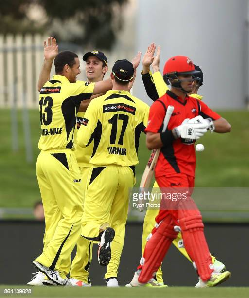 Nathan CoulterNile of the Warriors celebrates after taking the wicket of Jake Weatherald of the Redbacks during the JLT One Day Cup Final match...