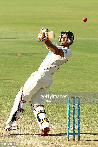 Nathan CoulterNile of the Warriors hits out during day two of the Sheffield Shield match between the Western Australia Warriors and the Tasmania...