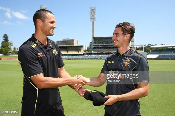 Nathan CoulterNile of Western Australia presents Andrew Holder with his cap during day one of the Sheffield Shield match between Western Australia...