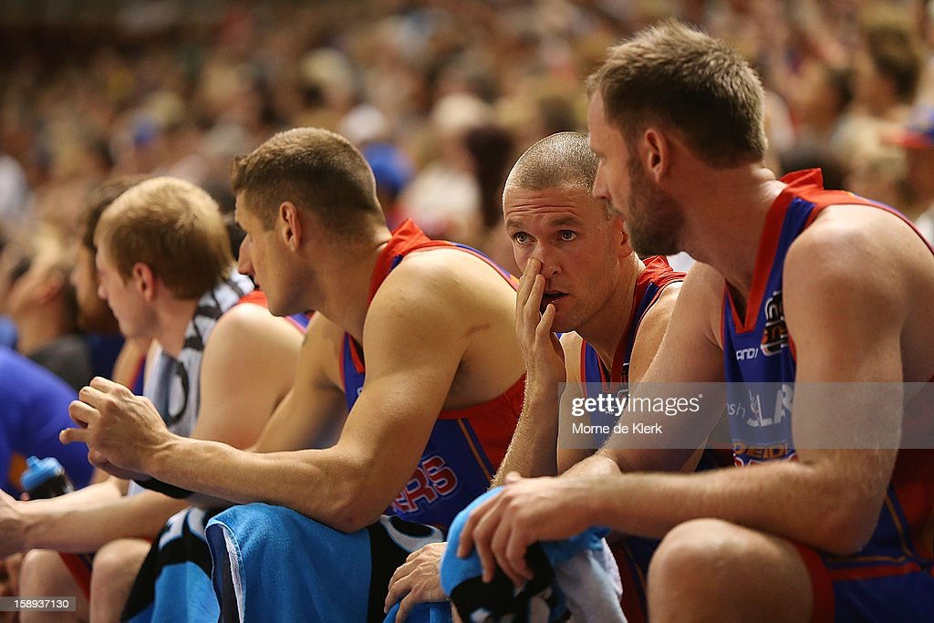<a gi-track='captionPersonalityLinkClicked' href=/galleries/search?phrase=Nathan+Crosswell&family=editorial&specificpeople=2113323 ng-click='$event.stopPropagation()'>Nathan Crosswell</a> of Adelaide sits on the bench during the round 13 NBL match between the Adelaide 36ers and the Townsville Crocodiles at Adelaide Arena on January 4, 2013 in Adelaide, Australia.