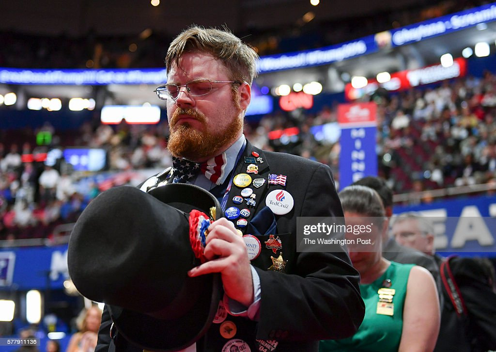 Nathan Dahlin alternate delegate from Oregon prays during the invocation on the second day of the Republican National Convention on Tuesday July 19...