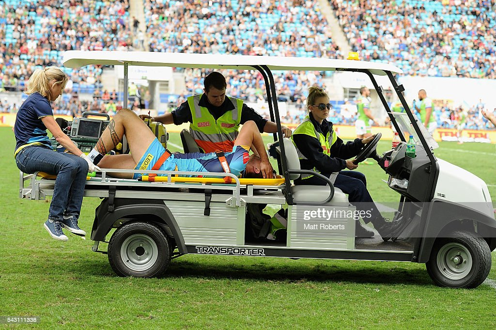Nathan Davis of the Titans leaves the field injured during the round 16 NRL match between the Gold Coast Titans and the Canberra Raiders at Cbus Super Stadium on June 26, 2016 in Gold Coast, Australia.