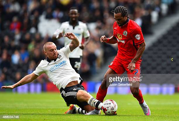 Nathan Delfouneso of Blackburn is tackled by Jamie O'Hara of Fulham FC at Craven Cottage during the Sky Bet Football League Championship match...
