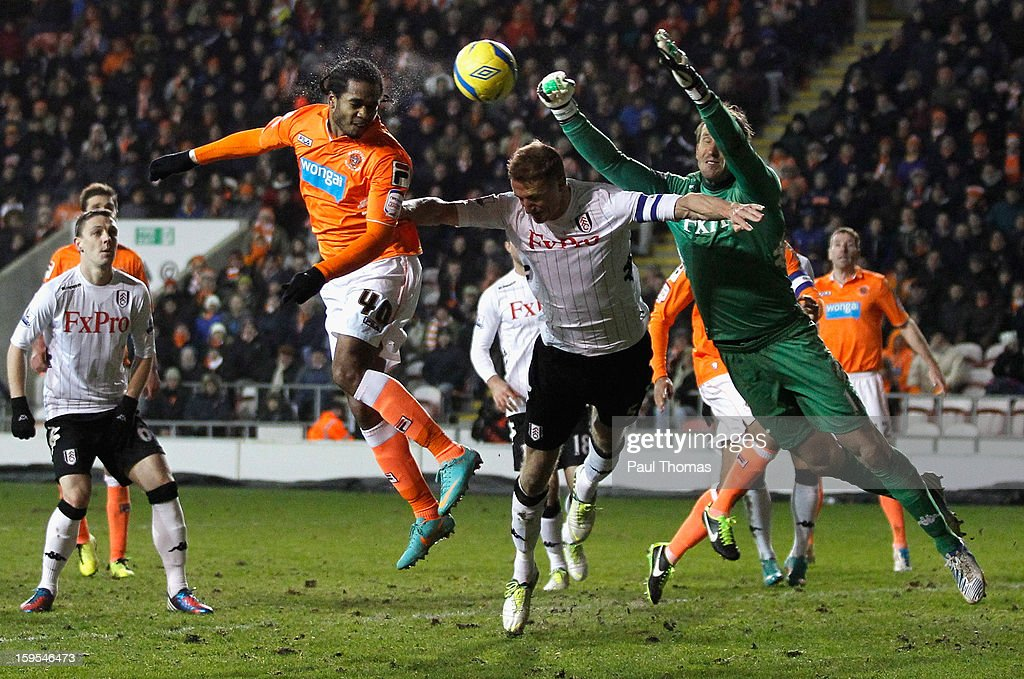 <a gi-track='captionPersonalityLinkClicked' href=/galleries/search?phrase=Nathan+Delfouneso&family=editorial&specificpeople=5448187 ng-click='$event.stopPropagation()'>Nathan Delfouneso</a> of Blackpool heads at goal under pressure from <a gi-track='captionPersonalityLinkClicked' href=/galleries/search?phrase=Mark+Schwarzer&family=editorial&specificpeople=208085 ng-click='$event.stopPropagation()'>Mark Schwarzer</a> (r) and <a gi-track='captionPersonalityLinkClicked' href=/galleries/search?phrase=Brede+Hangeland&family=editorial&specificpeople=618174 ng-click='$event.stopPropagation()'>Brede Hangeland</a> of Fulham during the FA Cup with Budweiser Third Round Replay match between Blackpool and Fulham at Bloomfield Road on January 15, 2013 in Blackpool, England.