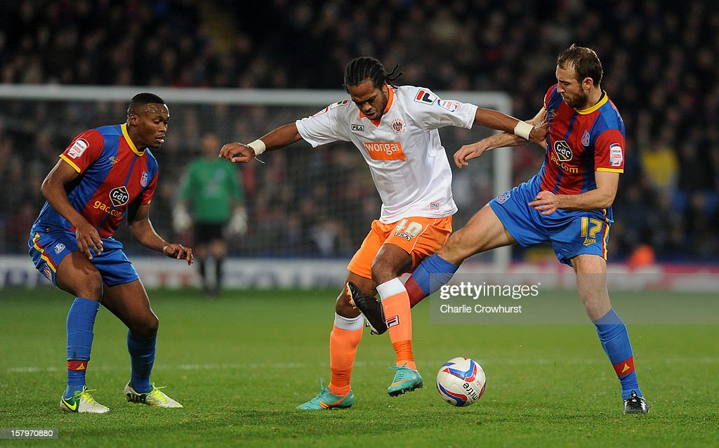 <a gi-track='captionPersonalityLinkClicked' href=/galleries/search?phrase=Nathan+Delfouneso&family=editorial&specificpeople=5448187 ng-click='$event.stopPropagation()'>Nathan Delfouneso</a> of Blackpool holds the ball up next to <a gi-track='captionPersonalityLinkClicked' href=/galleries/search?phrase=Glenn+Murray+-+Soccer+Player&family=editorial&specificpeople=15203667 ng-click='$event.stopPropagation()'>Glenn Murray</a> of Crystal Palace during the npower Championship match between Crystal Palace and Blackpool at Selhurst Park on December 08, 2012 in London, England.