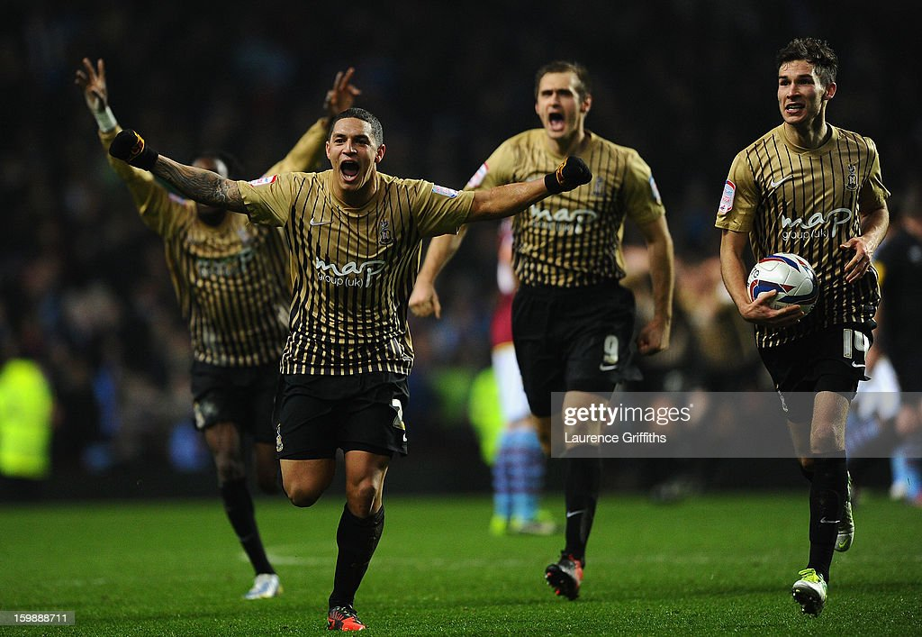 Nathan Doyle of Bradford City and his team-mates celebrate reaching the final at the end of the Capital One Cup Semi-Final Second Leg between Aston Villa and Bradford City at Villa Park on January 22, 2013 in Birmingham, England.