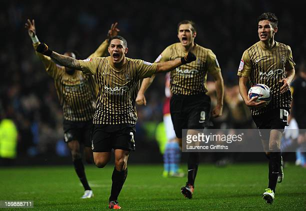 Nathan Doyle of Bradford City and his teammates celebrate reaching the final at the end of the Capital One Cup SemiFinal Second Leg between Aston...