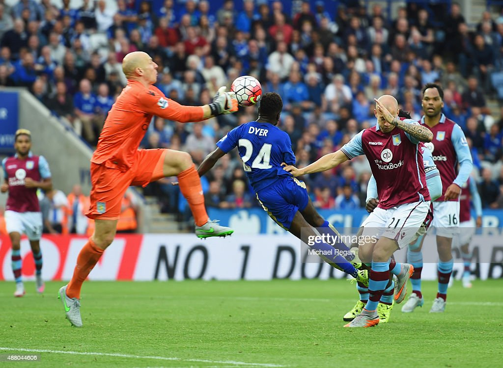 <a gi-track='captionPersonalityLinkClicked' href=/galleries/search?phrase=Nathan+Dyer&family=editorial&specificpeople=684113 ng-click='$event.stopPropagation()'>Nathan Dyer</a> of Leicester City (24) beats goalkeeper <a gi-track='captionPersonalityLinkClicked' href=/galleries/search?phrase=Brad+Guzan&family=editorial&specificpeople=662127 ng-click='$event.stopPropagation()'>Brad Guzan</a> of Aston Villa to score their third goal during the Barclays Premier League match between Leicester City and Aston Villa at the King Power Stadium on September 13, 2015 in Leicester, United Kingdom.