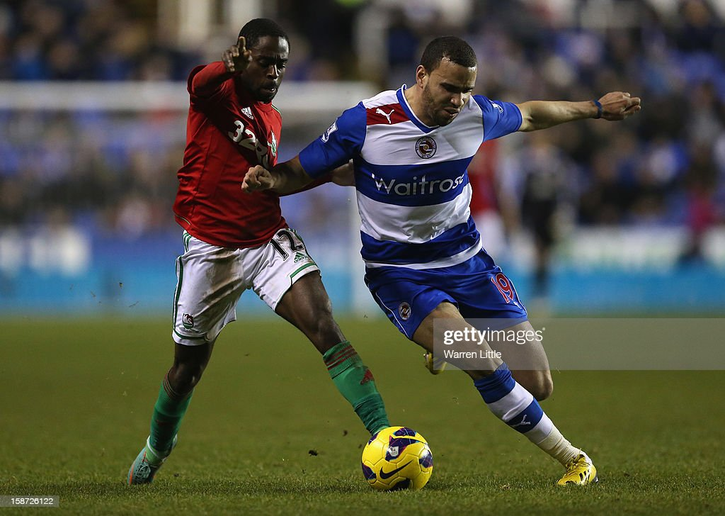 Nathan Dyer of Swansea City and Hal Robson-Kanu of Reading in action during the Barclays Premier League match between Reading and Swansea City at Madejski Stadium on December 26, 2012 in Reading, England.