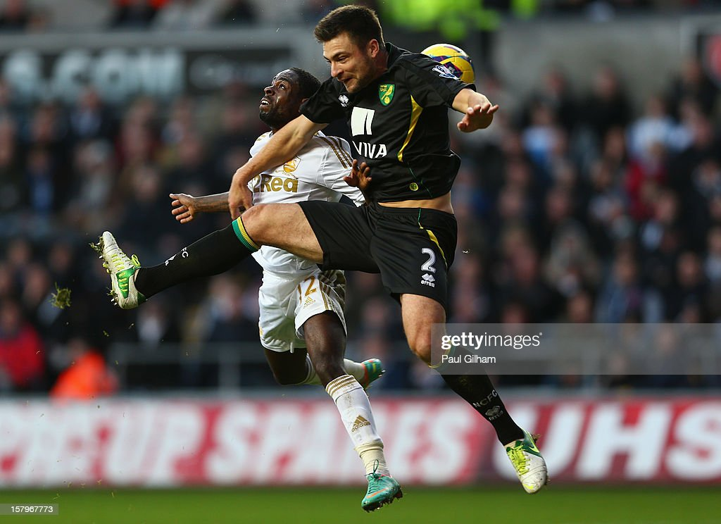 Nathan Dyer of Swansea City battles for the ball with <a gi-track='captionPersonalityLinkClicked' href=/galleries/search?phrase=Russell+Martin+-+Soccer+Player&family=editorial&specificpeople=13764026 ng-click='$event.stopPropagation()'>Russell Martin</a> of Norwich City during the Barclays Premier League match between Swansea City and Norwich City at the Liberty Stadium on December 8, 2012 in Swansea, Wales.