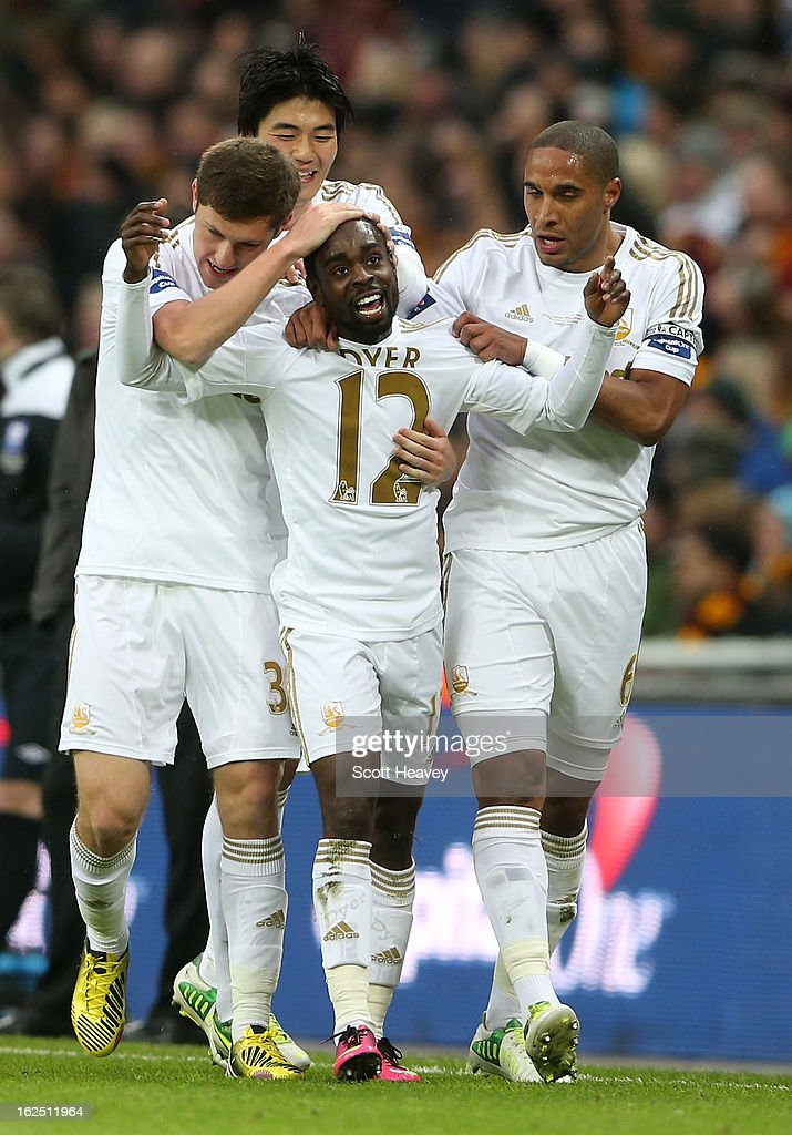 Nathan Dyer of Swansea City celebrates with team mates after scoring the opening goal during the Capital One Cup Final match between Bradford City and Swansea City at Wembley Stadium on February 24, 2013 in London, England.