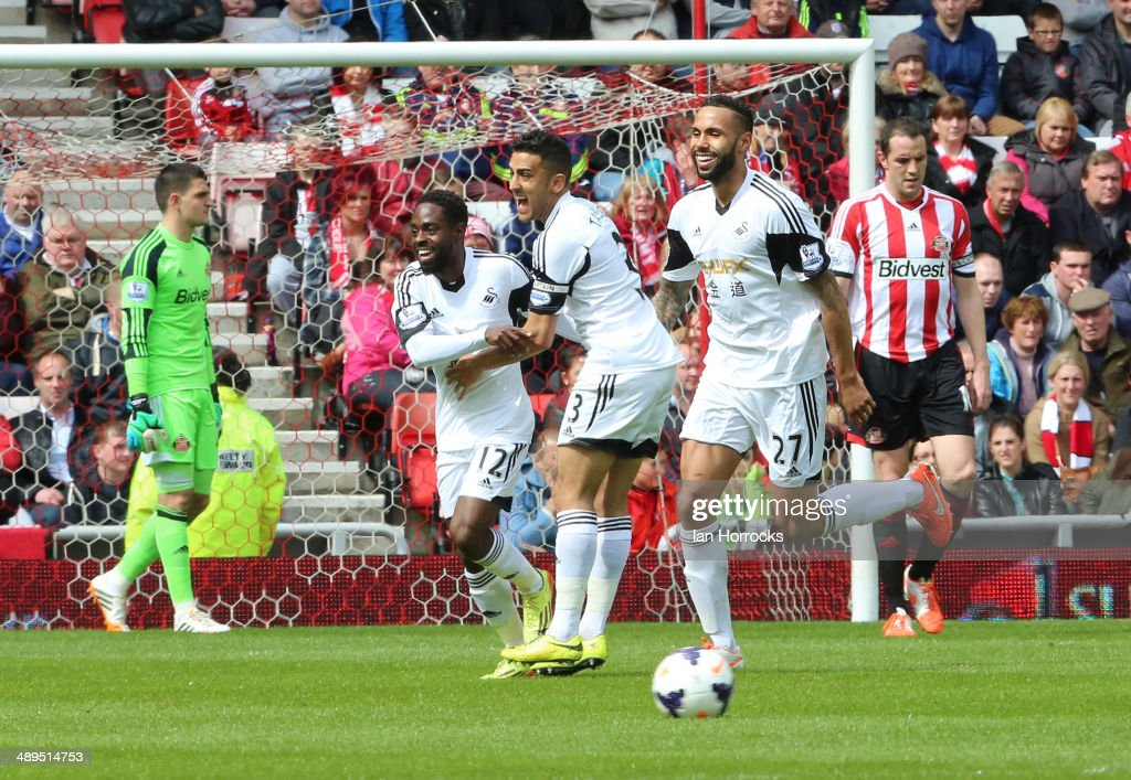 Nathan Dyer of Swansea City celebrates with team-mates Neil Taylor and Kyle Bartley after scoring the opening goal during the Barclays Premier League match between Sunderland and Swansea City at The Stadium of Light on May 11, 2014 in Sunderland, England.