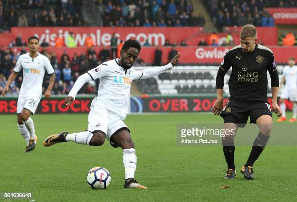 Nathan Dyer of Swansea City is marked by Marc Albrighton of Leicester City during the Premier League match between Swansea City and Leicester City at...