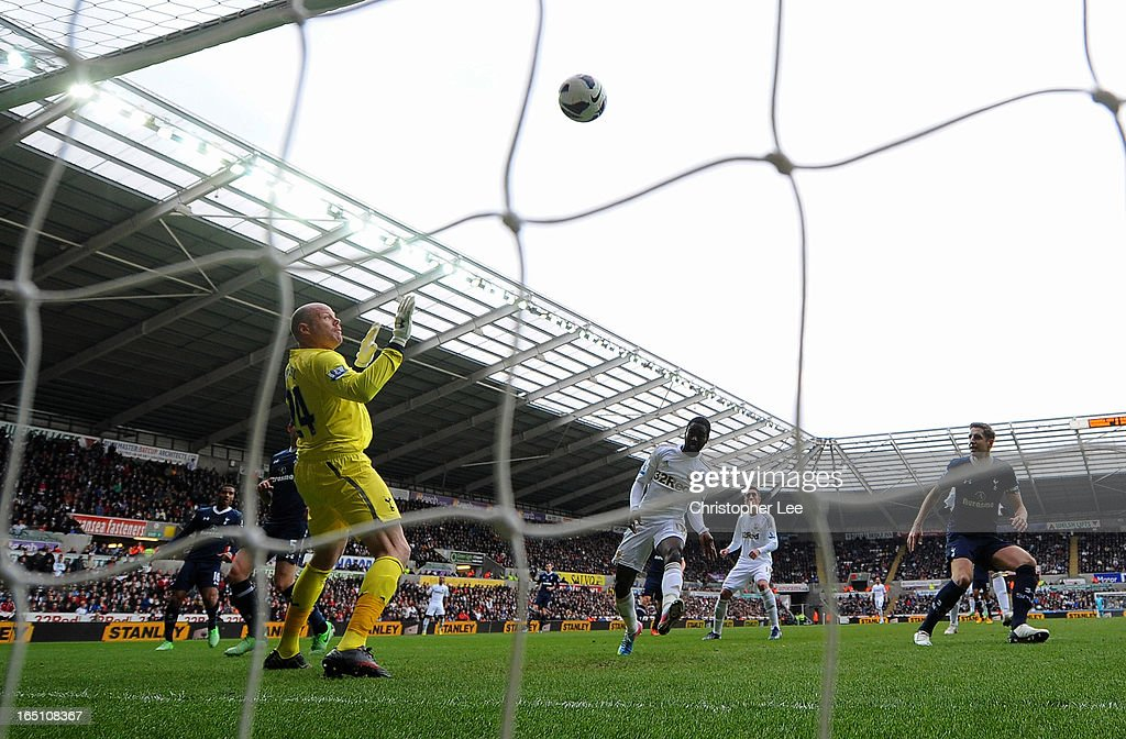 Nathan Dyer of Swansea hits the crossbar and then misses the rebound in front of <a gi-track='captionPersonalityLinkClicked' href=/galleries/search?phrase=Brad+Friedel&family=editorial&specificpeople=210857 ng-click='$event.stopPropagation()'>Brad Friedel</a> of Spurs during the Barclays Premier League match between Swansea City and Tottenham Hotspur at Liberty Stadium on March 30, 2013 in Swansea, Wales.