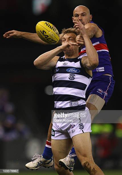 Nathan Eagleton of the Bulldogs spoils Darren Milburn of the Cats during the round 20 AFL match between the Western Bulldogs and the Geelong Cats at...
