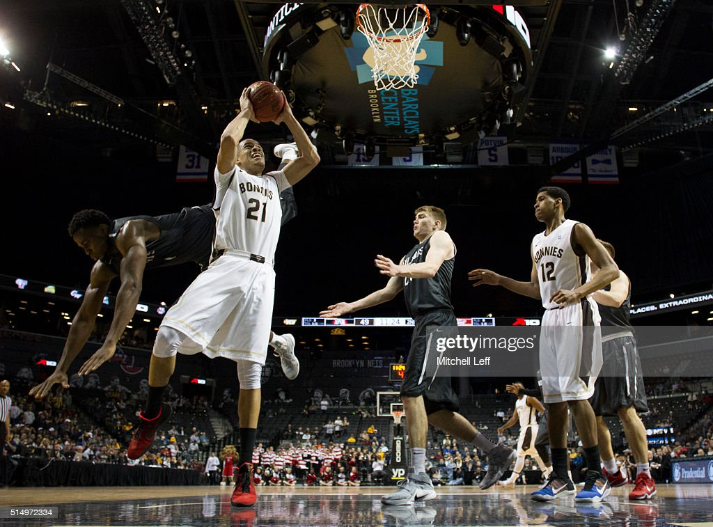 Nathan Ekwu of the Davidson Wildcats fouls Dion Wright of the St Bonaventure Bonnies in the quarterfinals round of the men's Atlantic 10 tournament...
