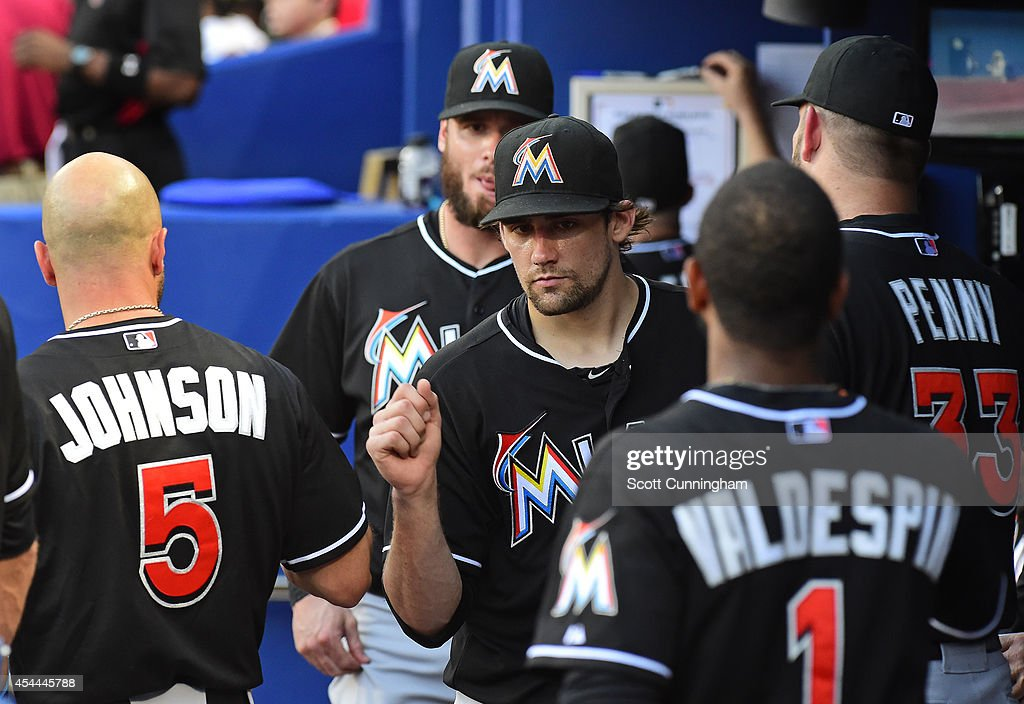 <a gi-track='captionPersonalityLinkClicked' href=/galleries/search?phrase=Nathan+Eovaldi&family=editorial&specificpeople=8023089 ng-click='$event.stopPropagation()'>Nathan Eovaldi</a> #24 of the Miami Marlins is congratulated by teammates after being removed from the game against the Atlanta Braves at Turner Field on August 31, 2014 in Atlanta, Georgia.