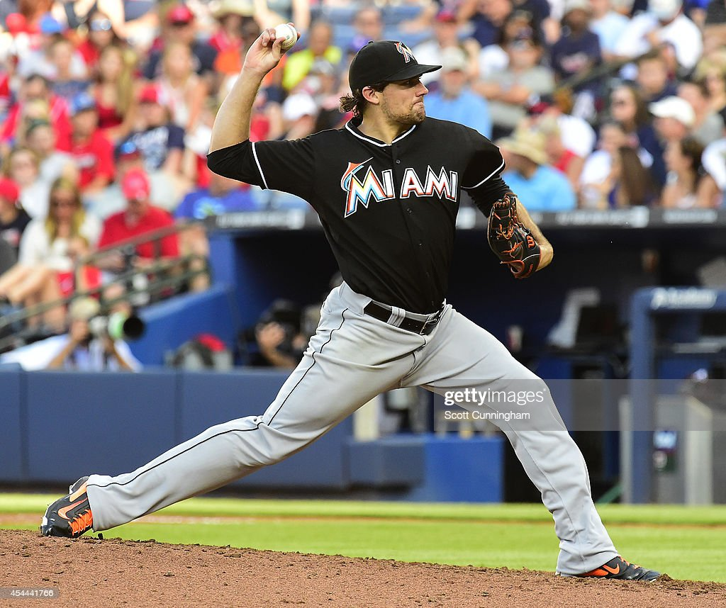 <a gi-track='captionPersonalityLinkClicked' href=/galleries/search?phrase=Nathan+Eovaldi&family=editorial&specificpeople=8023089 ng-click='$event.stopPropagation()'>Nathan Eovaldi</a> #24 of the Miami Marlins throws a fifth inning pitch against the Atlanta Braves at Turner Field on August 31, 2014 in Atlanta, Georgia.