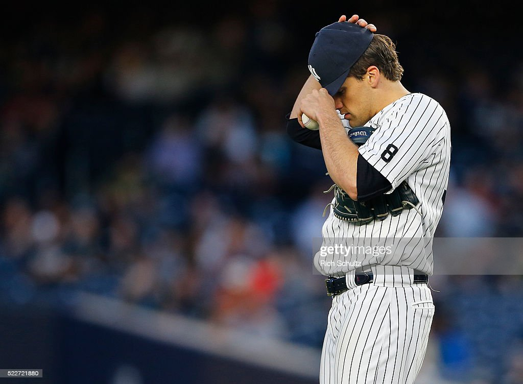 Nathan Eovaldi #30 of the New York Yankees adjusts his cap during the second inning against the Oakland Athletics at Yankee Stadium on April 20, 2016 in the Bronx borough of New York City.