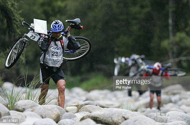 Nathan Fa'avave from the New Zealand team Balance Vector crosses the Giles Creek with his mountain bike on the third day of the Adventure Racing...