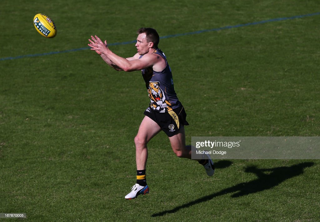 <a gi-track='captionPersonalityLinkClicked' href=/galleries/search?phrase=Nathan+Foley&family=editorial&specificpeople=561420 ng-click='$event.stopPropagation()'>Nathan Foley</a> marks the ball during a Richmond Tigers AFL training session at ME Bank Centre on May 2, 2013 in Melbourne, Australia.