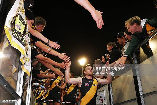 Nathan Foley of the Tigers celebrate his win with fans during the round two AFL match between the Richmond Tigers and the Carlton Blues at Melbourne...