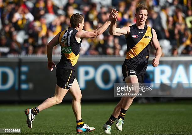 Nathan Foley of the Tigers celebrates his goal with Jack Riewoldt during the round 20 AFL match between the Richmond Tigers and the Brisbane Lions at...